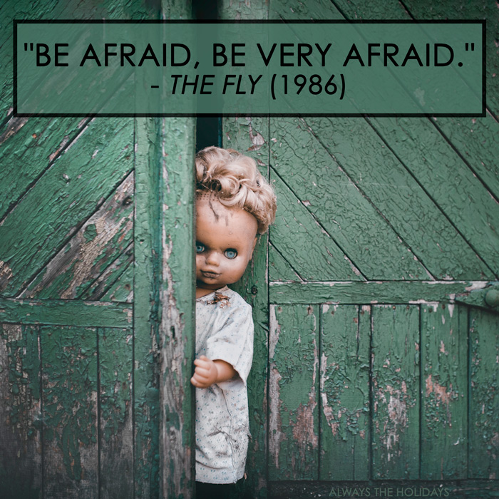 "A scary doll emerging from a creepy green shed with the Halloween quote overlay ""be afraid, be very afraid""."