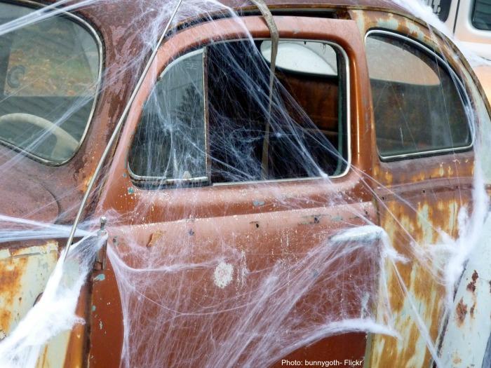 Spider webs on an old car.