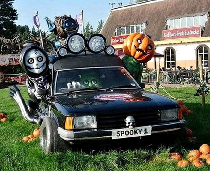 Halloween car decorations: Hearse decorated for Halloween.