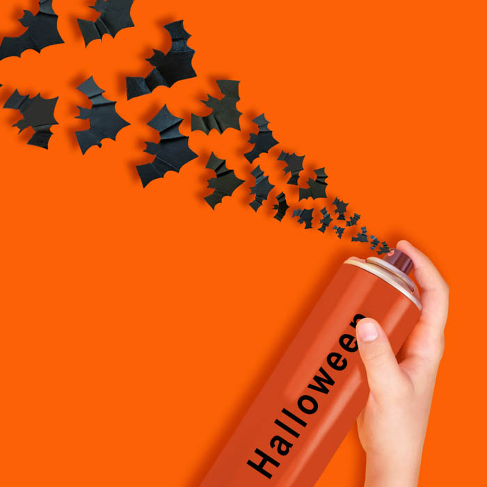 "An orange spray can labeled ""Halloween"" that sprays out bats."