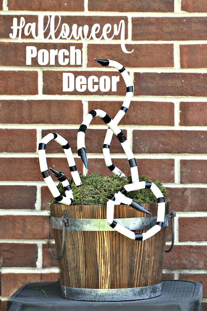 Beetlejuice inspired Halloween porch decor with snakes in a bucket.