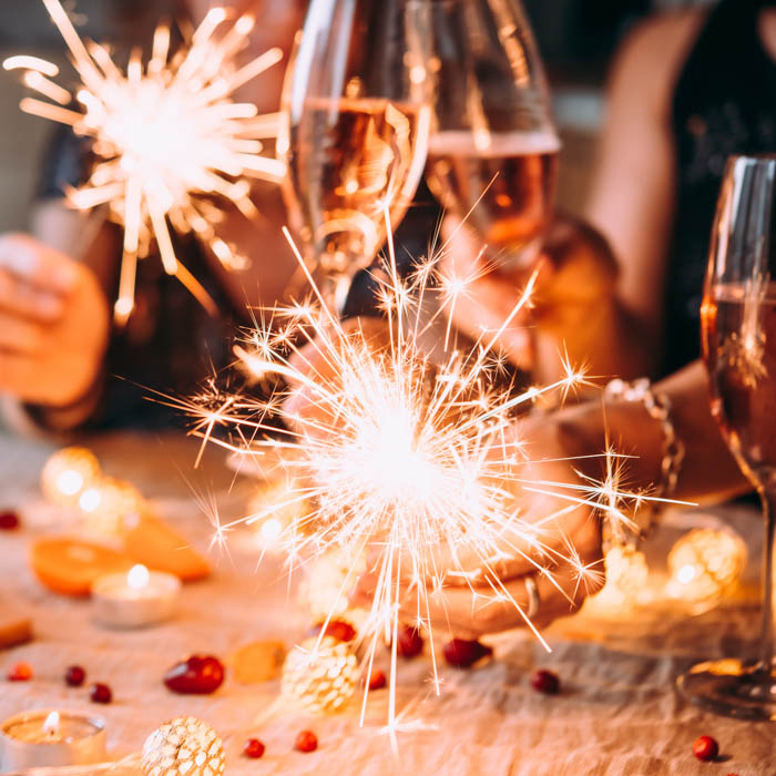 A holiday celebration with sparkling rose and sparklers.