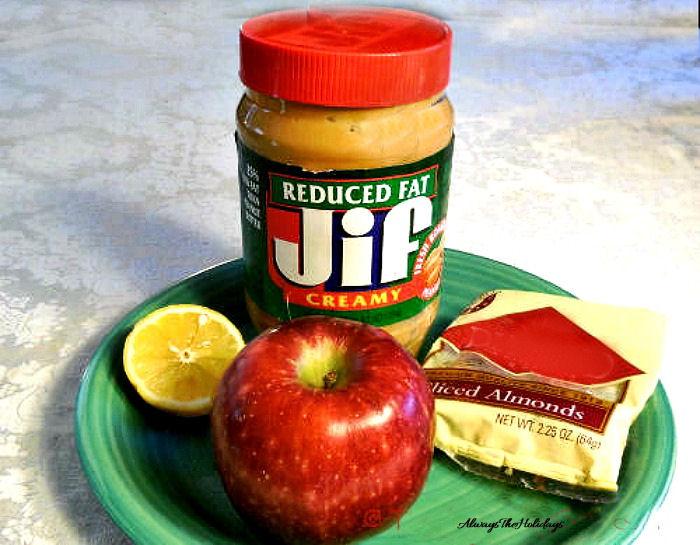 Peanut butter, walnuts, lemon slice and apple.
