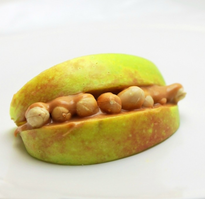 Apple mouth with peanut butter and peanuts