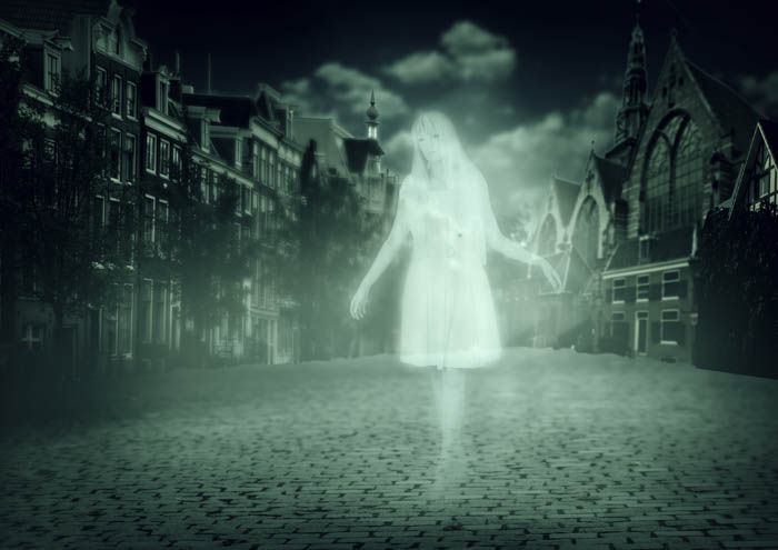 A ghostly woman walking through a spooky ghost town.