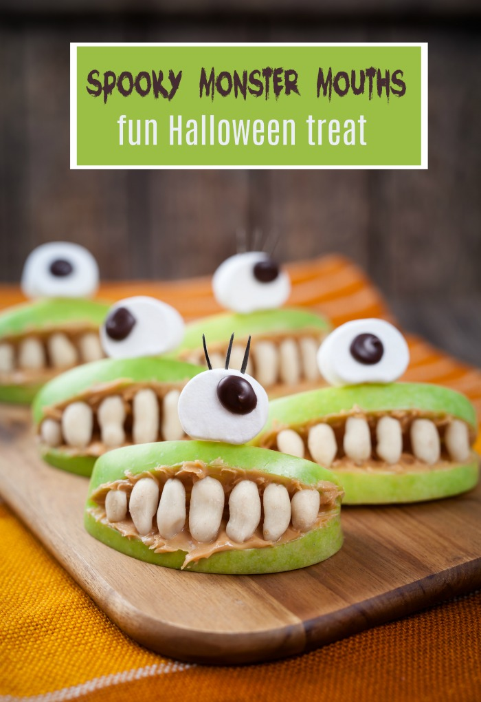 "Apples made into mouths with big eyes and text reading ""Spooky monster mouths - fun Halloween snack."""
