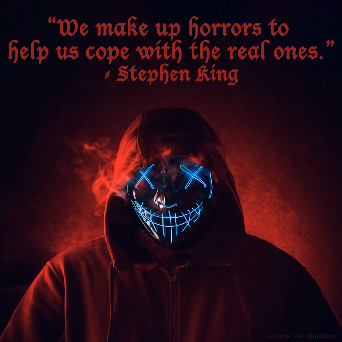 A man with a neon blue mask wearing a hoodie in a red fog with a Stephen king Halloween quote text overlay.