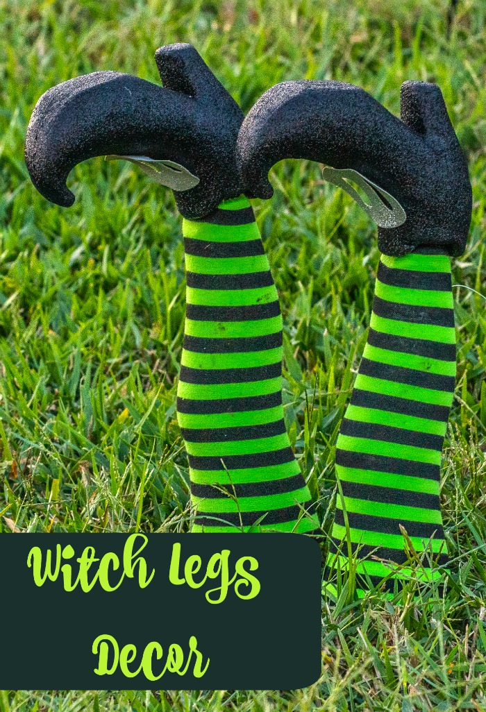 DIY witch legs decor overlay on two green and black striped legs with black shoes.
