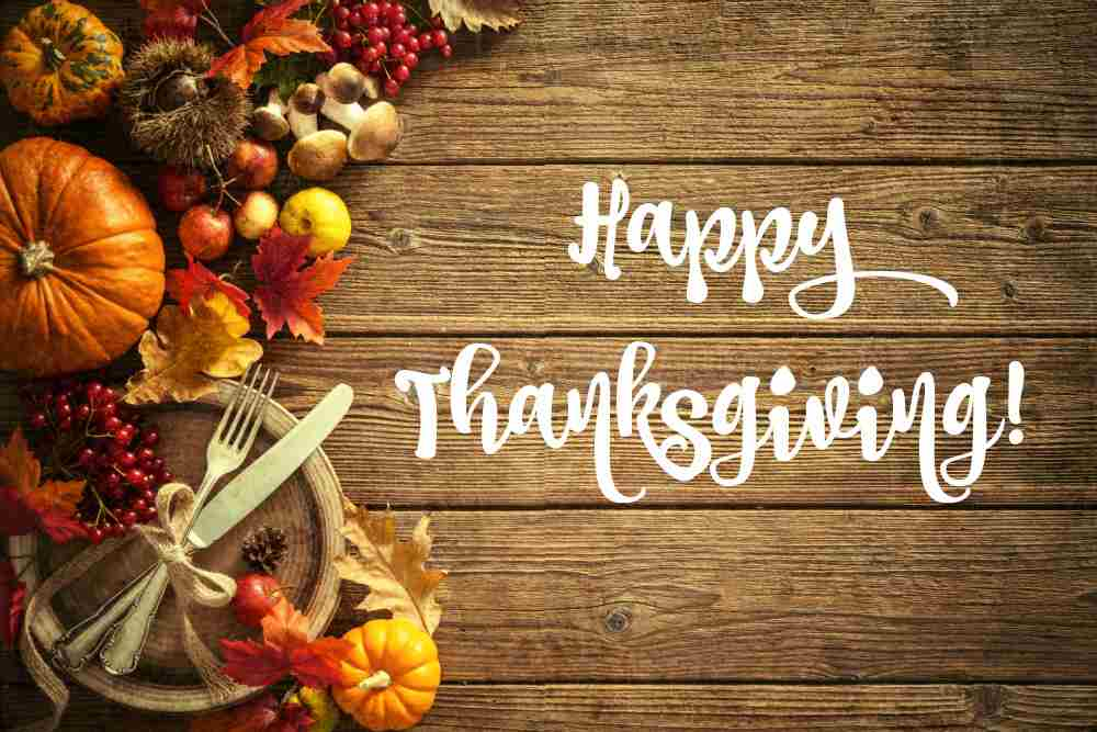 Fall food with knife and fork and words Happy Thanksgiving.