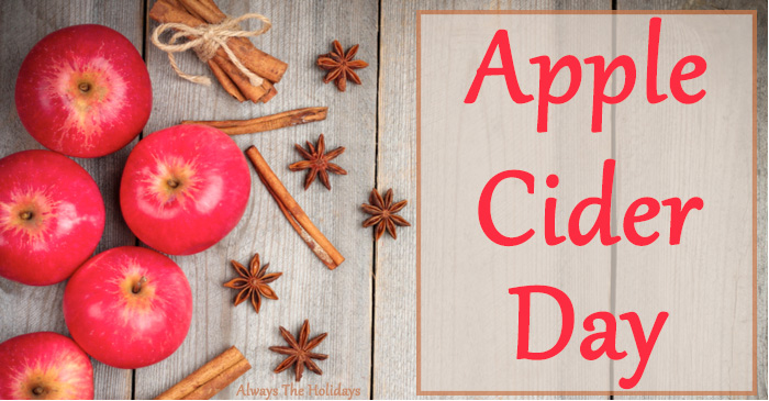 "An overhead view of apple cider ingredients with a text overlay reading ""apple cider day""."