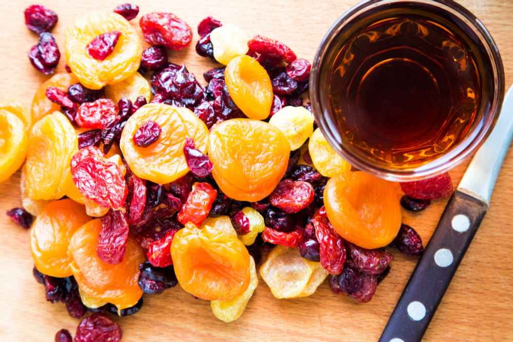 Cut up fruit and brandy.