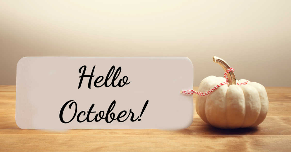 """White pumpkin with a card that says """"Hello October!"""""""