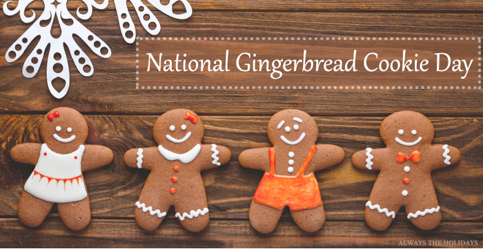 """Four gingerbread men cookies on a wooden board with a text overlay reading """"National Gingerbread Cookie Day""""."""