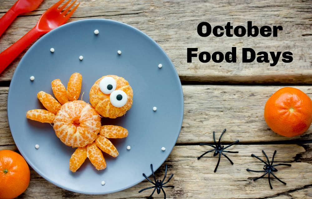Spider with edible eyes made of mandarins with words October food Days.