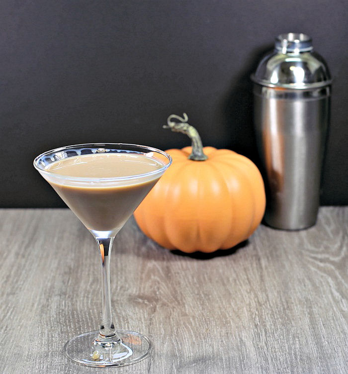 Ghostbuster cocktail with pumpkin nd cocktail shaker.