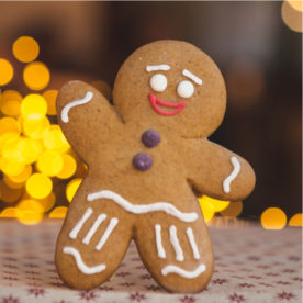 A gingerbread man cookie standing and waving.