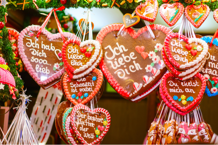 Gingerbread cookies with love messages hanging in a booth at a Christmas Market in Germany.