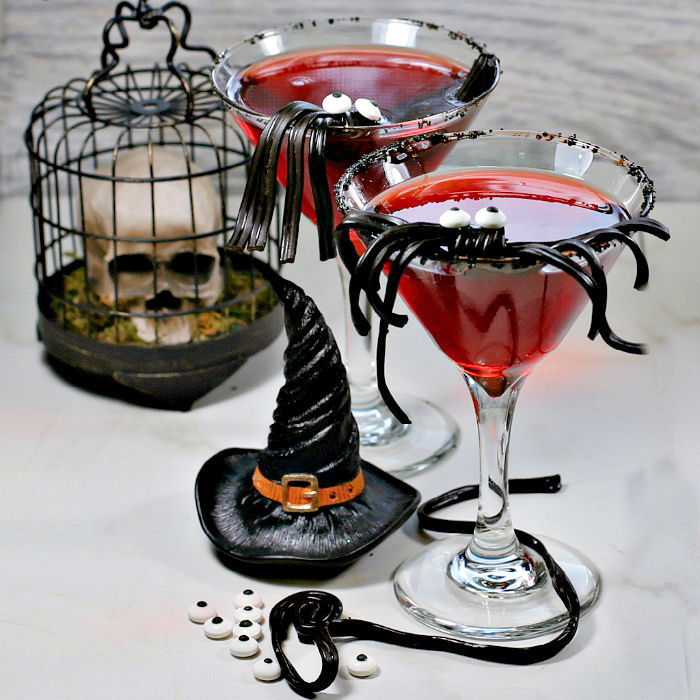 Vampire cranberry cocktail with licorice spider garnish
