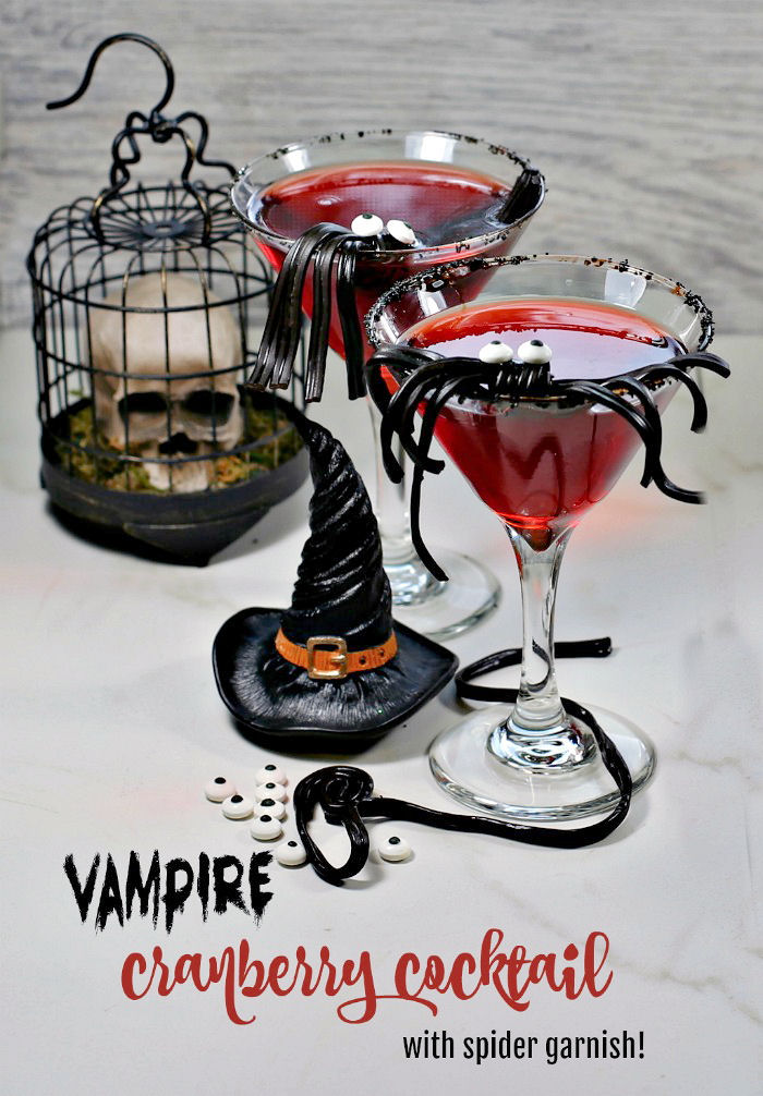 """Red drink with skull and witch hat with words """"vampire cranberry cocktail with spider garnish."""""""
