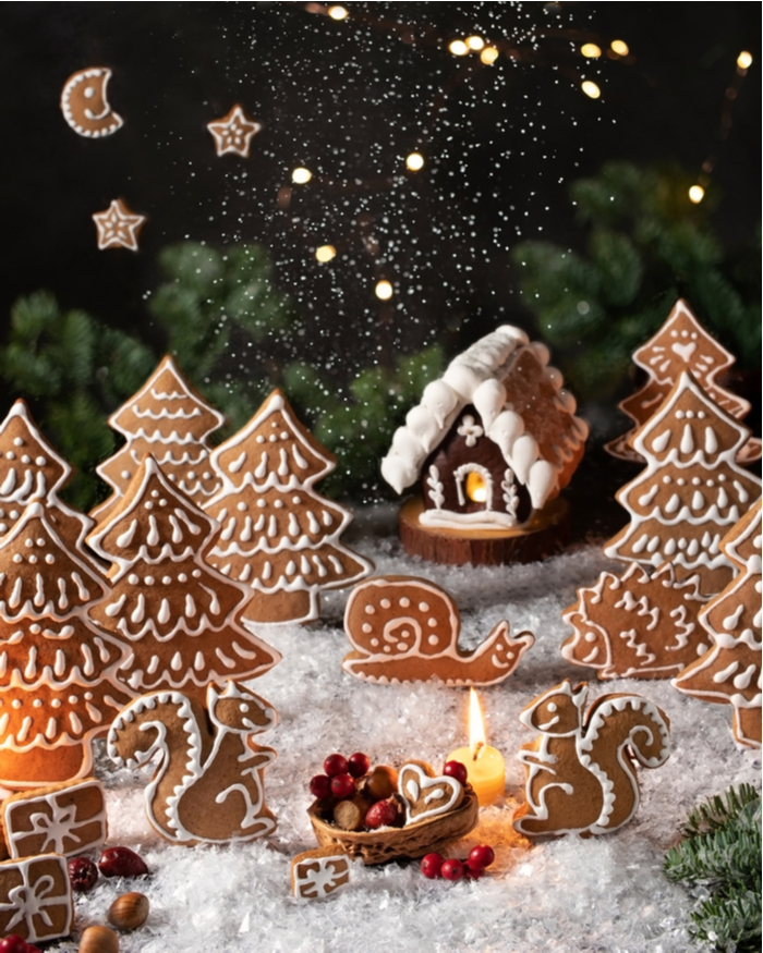 A Christmas gingerbread display with gingerbread trees, stars, a moon and a gingerbread house.
