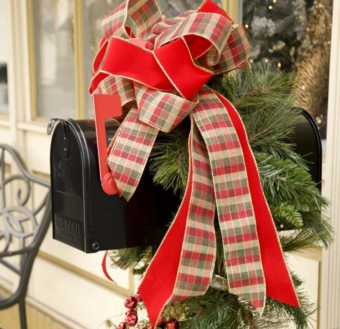 plaid and red ribbon on a black mailbox.