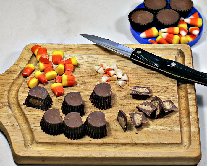 Peanut butter cups and candy corn with pieces cut off to make turkey cookies.
