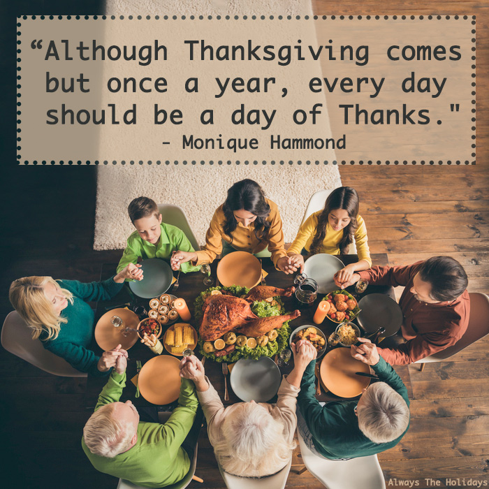 A family sitting around a Thanksgiving table holding hands in prayer with a Thanksgiving thankful quote text overlay.