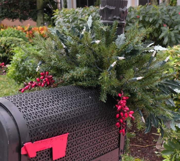 Mailbox swag with lights, holly leaves and berries.