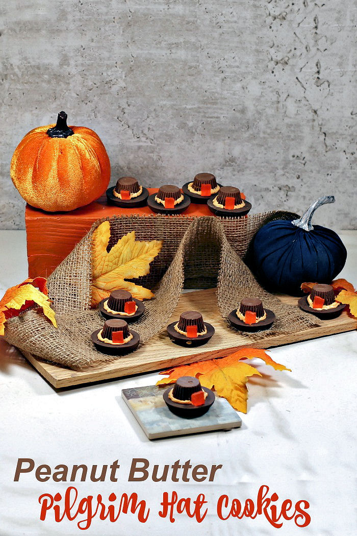 """Cookie pilgrim hats in a Thanksgiving centerpiece with burlap and silk leaves and text reading """"Peanut butter pilgrim hat cookies."""""""