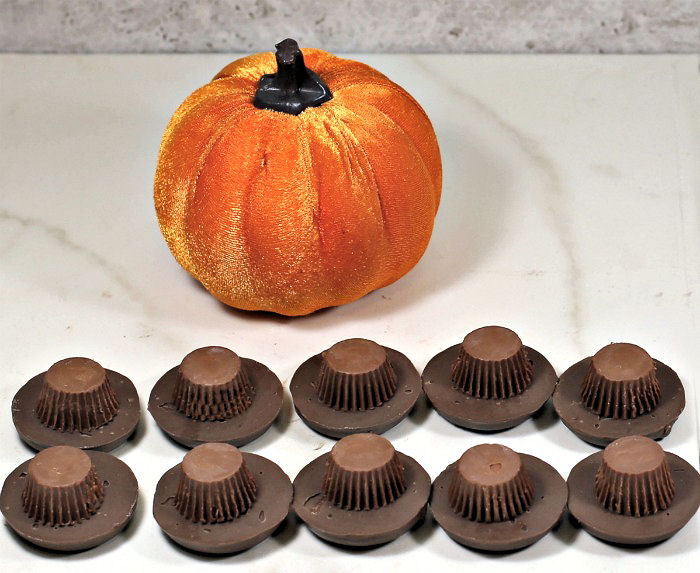 Chocolate cookies and peanut butter cups in the shape of a hat.