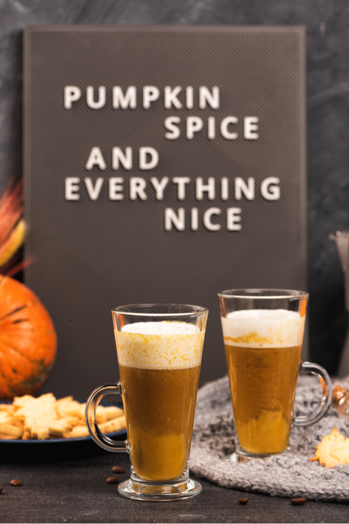 "Two pumpkin spiced lattes with a text overlay reading ""pumpkin spice and everything nice.""."