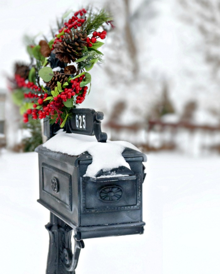 Black mailbox with swag wreath for Christmas.