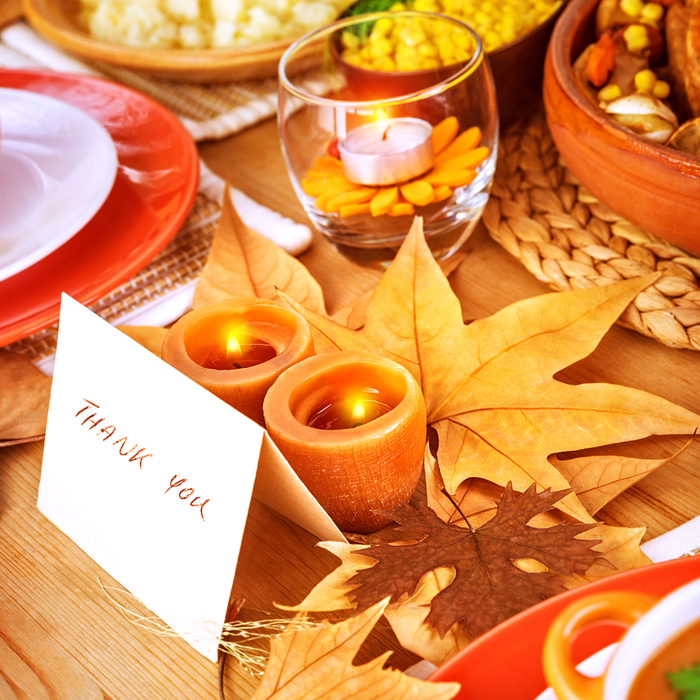 "A ""thank you"" place card on a decorated Thanksgiving table."