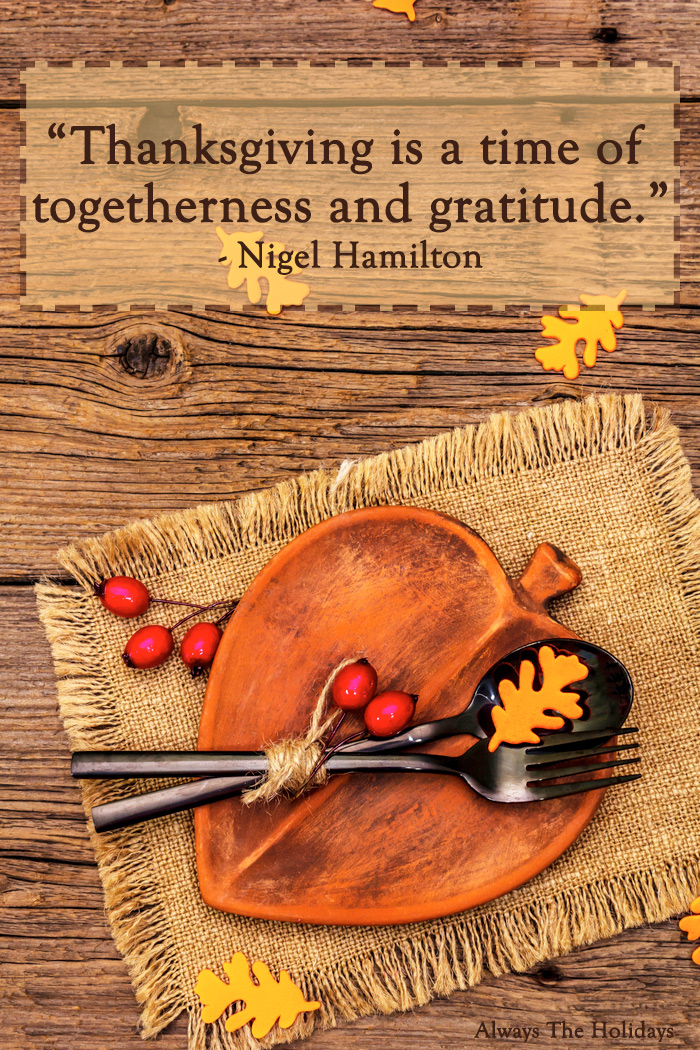 An orange plate on a burlap placemat on top of a wooden table with a Thanksgiving quote overlay.