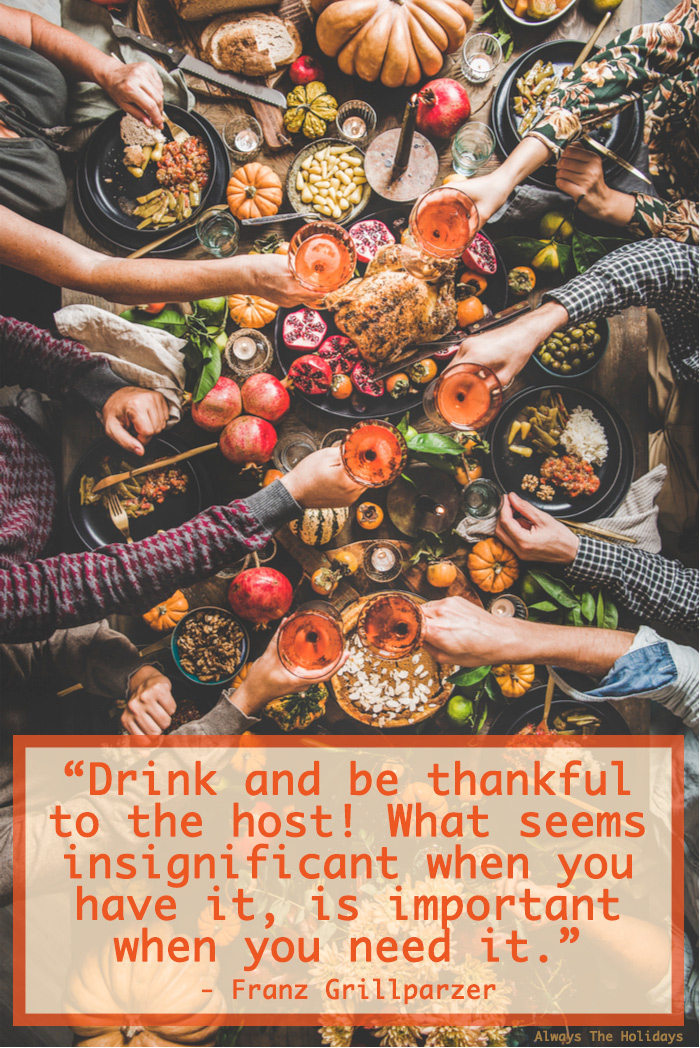 An overhead shot of a people clinking glasses over a Thanksgiving table filled with food and there is a Thanksgiving quote text overlay on the bottom.