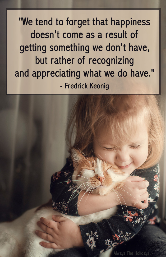 A little girl hugging a kitten with a Thanksgiving thankful quote overlay.