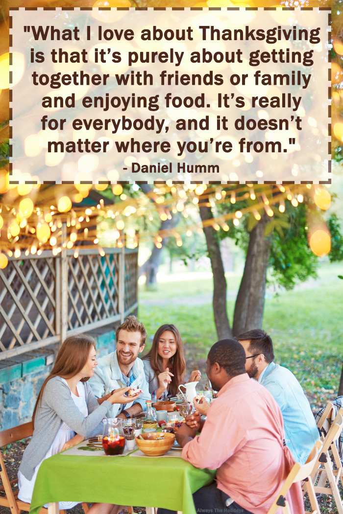 A table of friends in a backyard with a Thanksgiving friend quote text overlay.
