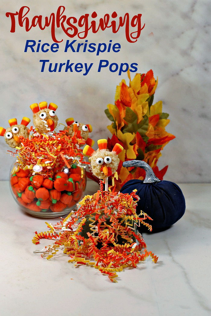 """Turkey pops in bowl of candy pumpkin and crinkled paper with words reading """"Thanksgiving Rice Krispie turkey pops."""""""