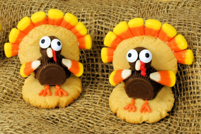 Turkeys made of sugar cookies, peanut butter cups, malted milk balls and candy corn.