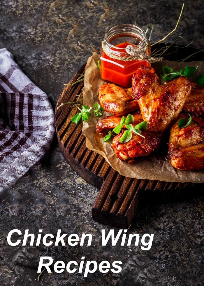 For Super Chicken Wing Day: Chicken wings on a cutting board with sauce and a checked towel.