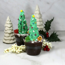 Christmas tree dirt cups with porcelain trees and Christmas decorations.