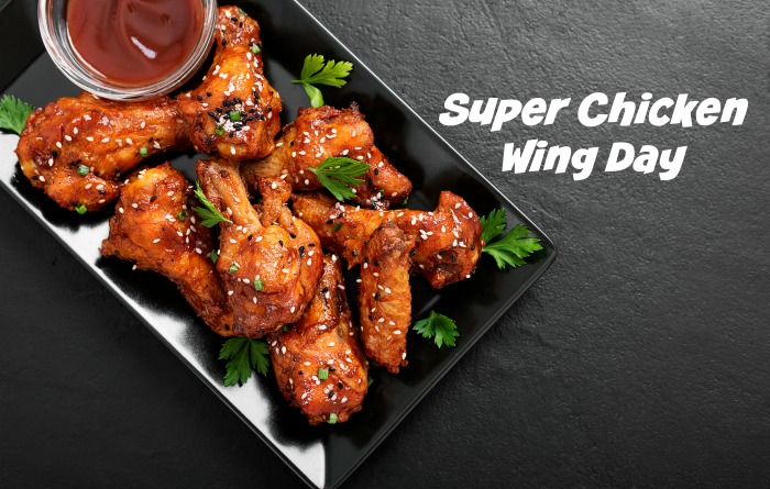 Plattter of wings and sauce with words reading Super Chicken Wing Day.