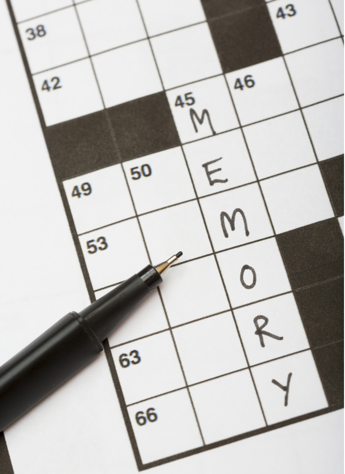 "A crossword puzzle with the word ""memory"" filled in to illustrate that puzzles improve memory."