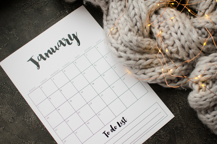 January national days calendar next to a scarf wrapped in twinkle lights.