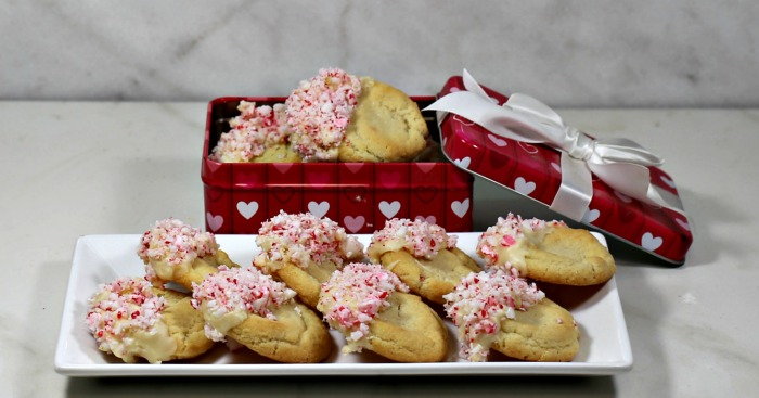 White chocolate peppermint cookies in a heart box and on a white plate.