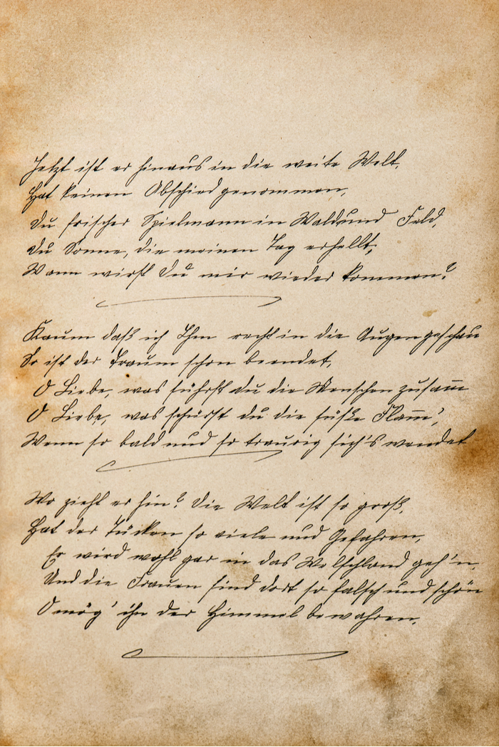 A vintage letter with cursive writing to honor National Handwriting Day.