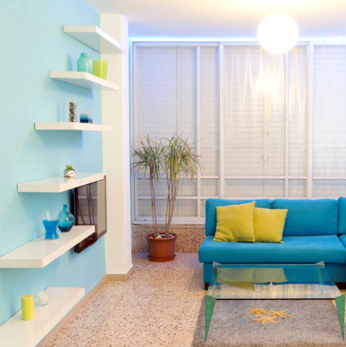 Room decorated in blue and yellow.