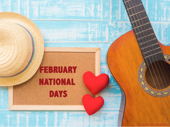 """A cork board reading """"February National Days"""" between a sun hat and an acoustic guitar."""