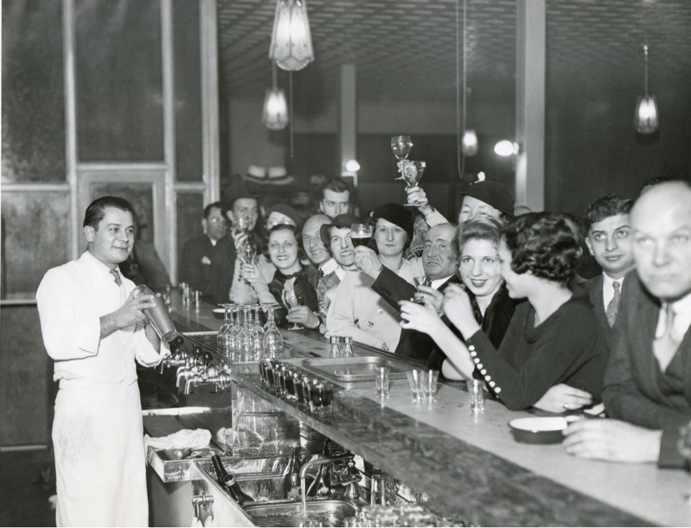 A vintage photo showing the history of bartending with a picture taken when prohibition ended in the United States.