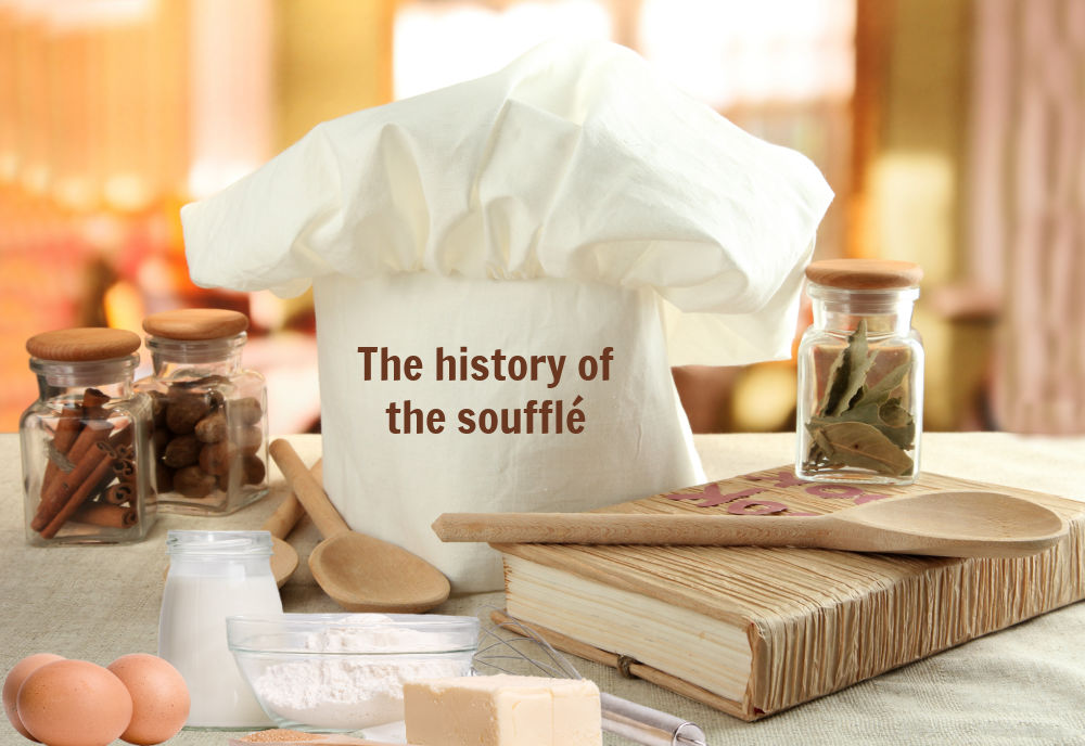 Chef hat, books, spices, eggs, butter and flour with words reading History of soufflés.
